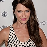 The League actress Katie Aselton paired a half-updo with a hot-pink lip.