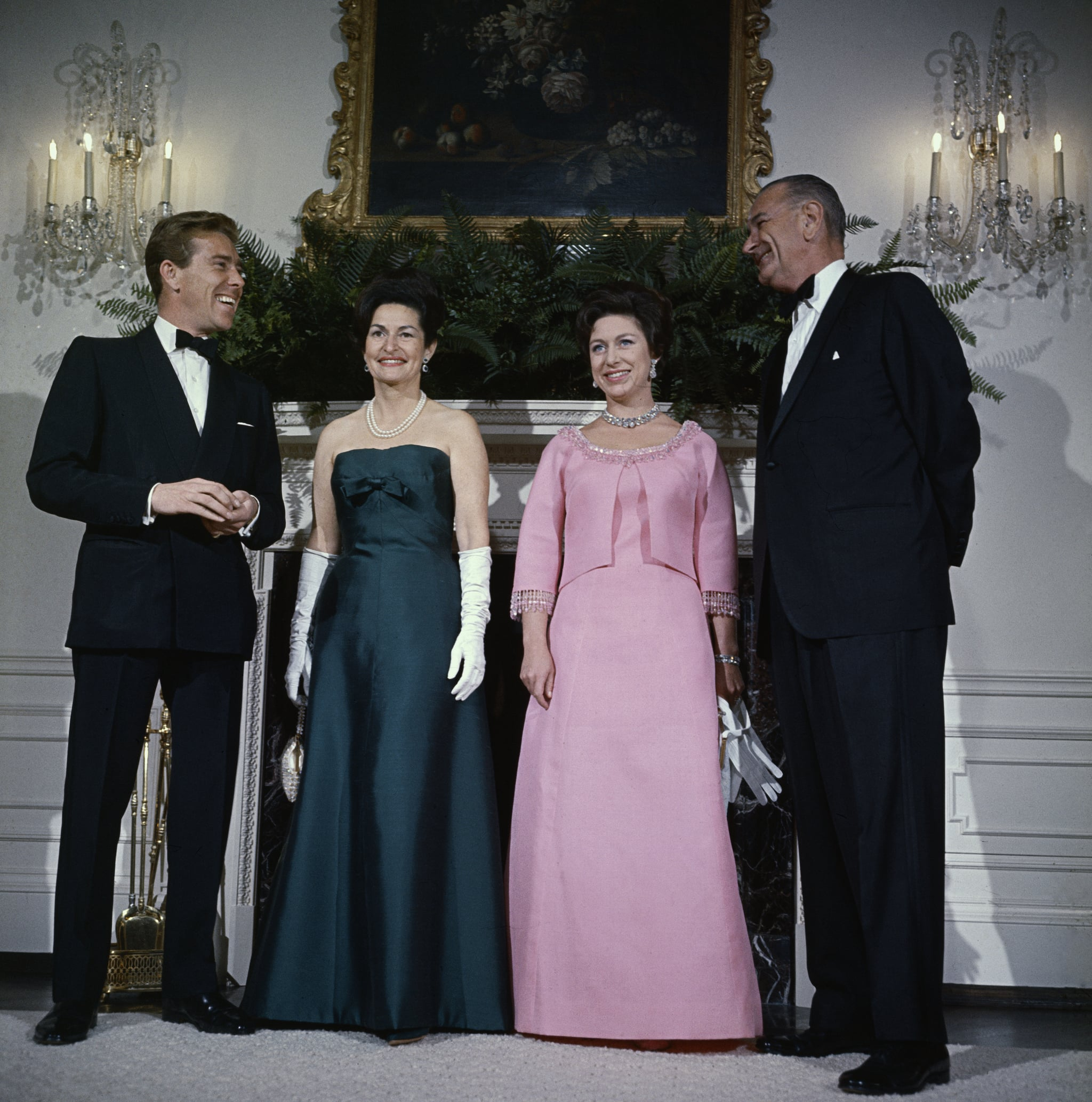 (Original Caption) President Lyndon Johnson (R), Princess Margaret, Mrs. Johnson, and Lord Snowdon pose for photographers in the Queen's room at the White House November 17th, prior to a dinner-dance in honour of the Princess and Lord Snowdon.