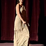Penelope Cruz showed off her Michael Kors gown on stage at the premiere of To Rome With Love in LA.
