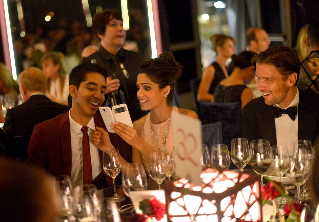 Dev Patel and Freida Pinto enjoyed some laughter together during dinner.