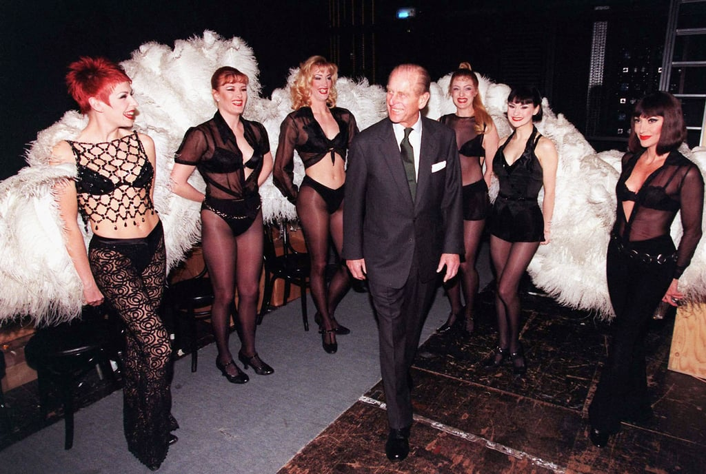 Members of the cast of Chicago surrounded Prince Philip at the Adelphi Theater on March 4, 1999.