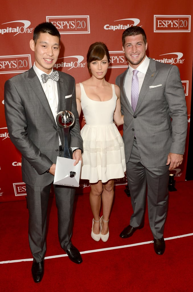 "Jessica Biel posed between Jeremy Lin and Tim Tebow backstage at the ESPY Awards in LA on Wednesday evening. Jessica and Tim teamed up on stage to present the Breakout Athlete of the Year award, which went to Lin for his season on the New York Knicks. Jessica wore a sexy Christian Dior dress for the occasion and tweeted on her way to the show that she hoped she wouldn't slip up in front of the conservative Tebow, saying, ""Dear God, please don't let me swear in front of @timtebow at the ‪#espys‬ tonight when we present. Love, Jess."" Jessica also praised the night's master of ceremonies, Rob Riggle, but asserted that her fiancé, Justin Timberlake, was the best ESPY host of all time.  Jessica is gearing up for a busy few weeks promoting Total Recall ahead of its Aug. 3 release. Jessica Biel is on the August cover of InStyle, and in the magazine she talked about her engagement ring, her stylish man JT, and having kids with him someday. Justin and Jessica are rumored to be tying the knot later this Summer, and until then she seems to be enjoying working some bridal white into her red-carpet choices."