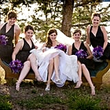 Tessa's bridesmaids wore matching halter charcoal and navy dresses.