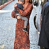 While on mommy duty, Miranda donned a paisley print maxi dress by Skaist Taylor with studded sandals and aviator sunglasses.