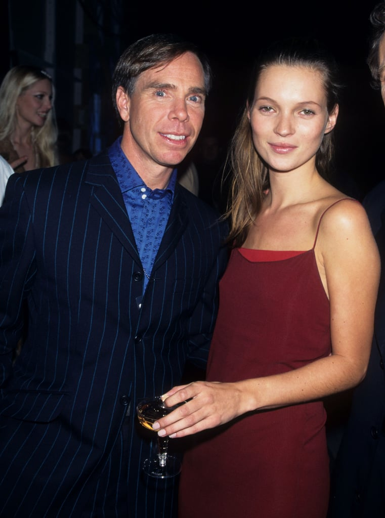 Wearing a red slip dress, with Tommy Hilfiger in 1995.