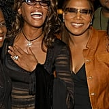 Whitney and Queen Latifah flash big smiles at VH1 Divas Duets in 2003.