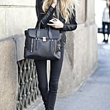 All black made all the more chic with a Pashli in hand.