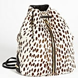 Elizabeth and James Spotted Calf Hair Drawstring Backpack ($545)