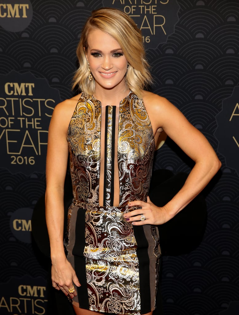 "It was an incredibly big night for Carrie Underwood at the CMT Artists of the Year event in Nashville on Wednesday night. In addition to hitting the red carpet with The Final Five's Aly Raisman and Madison Kocian, the singer presented Shania Twain with the artist of a lifetime award and took the stage for an amazing performance of her hit song ""Like I'll Never Love You Again."" Carrie, who attended the show with husband Mike Fisher, was honored for the fourth consecutive time for her success in country music over the last 12 months. At the end of the show, Carrie shared a snap of her and Mike backstage on Instagram, gushing, ""How I ended up snagging this handsome hunk, I'll never know, but I thank God that I did! I don't know what I'd do without him!"" The 2016 CMT Artists of the Year special is set to air on Oct. 20 at 9 p.m. EST on CMT.      Related:                                                                                                           12 Ridiculously Cute Pictures of Carrie Underwood's Son, Isaiah Fisher"