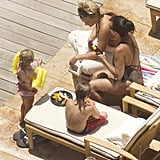 Jamie Lynn Spears and Lynne Spears eat by the pool.