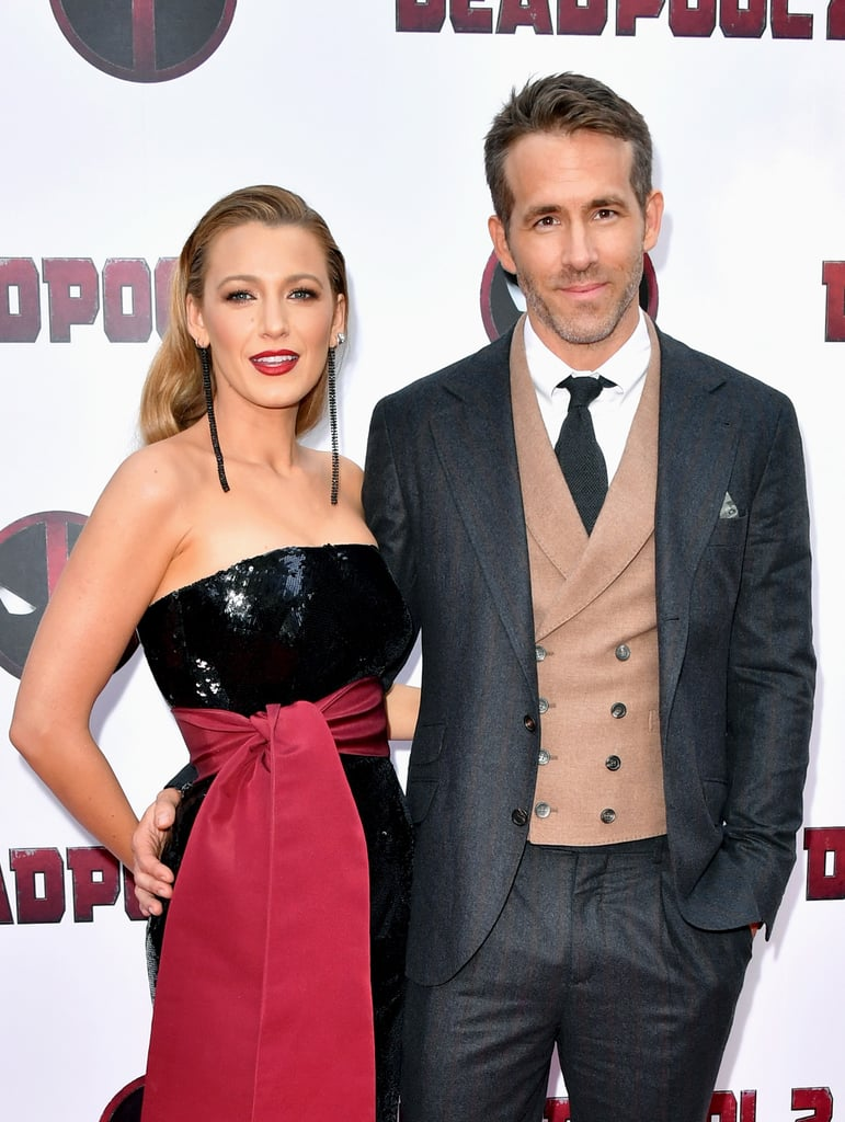 Blake Lively and Ryan Reynolds continue to win our hearts again and again with every public appearance they bless us with. The pair stepped out on May 14 to celebrate the premiere of Ryan's film Deadpool 2, and they only had eyes for each other.  While we're used to chuckling on our own over Blake and Ryan's back-and-forth social media comments, it appears the couple spent time swapping private jokes IRL on the red carpet. Just look at Ryan whisper in her ear — our hearts, they melt. They were even caught in their signature couples pose (they pinned one down before they started dating)! Keep scrolling to see more pics of the duo's night out, and feel free to reminisce on the days when they first fell in love.