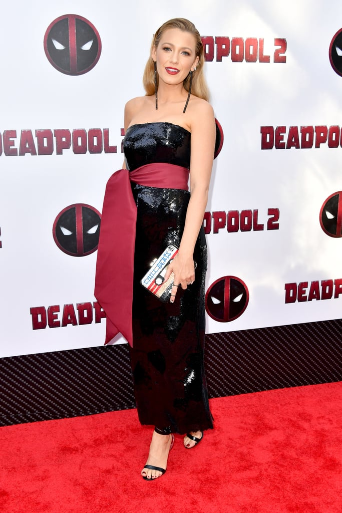 "From the Met Gala to a movie premiere, find yourself a fashion icon who can do both. Blake Lively stepped out a week after the 2018 Met Gala to support her husband, Ryan Reynolds, at the Deadpool 2 premiere on May 14. She took the film's color palette to heart and wore a strapless Brandon Maxwell sequined dress with a deep red sash tied high on her waist. She paired the gorgeous dress with Ofira Jewels dangling earrings, a Lorraine Schwartz bracelet and ring, a ""Chill Beats/Party Mix"" clutch, and Christian Louboutin strappy sandals with a transparent PVC heel. Keep scrolling to see even more angles of Blake's outfit and shop the exact pair of heels she wore on the red carpet. Careful . . . they'll take your breath away.       Related:                                                                                                           Blake Lively's Ultrafeminine Pink Dress Is Straight Out of Our Lisa Frank Dreams"