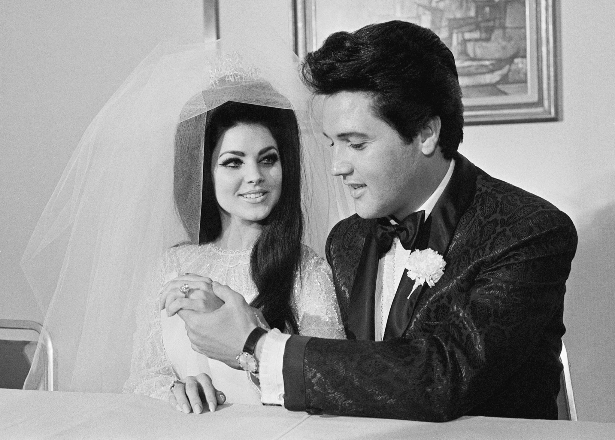Elvis Presley shows off his wife Princilla's three-carat diamond wedding ring on their wedding day in Las Vegas.