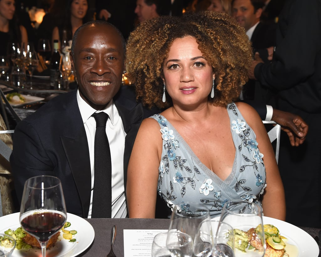 """Looks like we can add Don Cheadle and Bridgid Coulter to the growing list of celebrities that secretly married this past year. During his June 30 appearance on The Ellen DeGeneres Show with guest host Wanda Sykes, the Marvel star revealed that he married his longtime partner amid the COVID-19 pandemic. Although they've been together since 1992, it's unclear how the pair met. The couple also share two adult daughters together, Ayana and Imani. In addition to founding the """"physical and digital life-work gathering space"""" Blackbird House and her current career as an interior designer, Bridgid is an actress that has appeared alongside Don on House of Lies, Black Monday, and in 1997's Rosewood. Ahead, you can see some of their cutest moments from over the years!"""