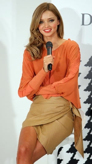 Model Miranda Kerr in Orange Blouse and Tan Skirt Hosting In-Store Fashion Workshop at David Jones