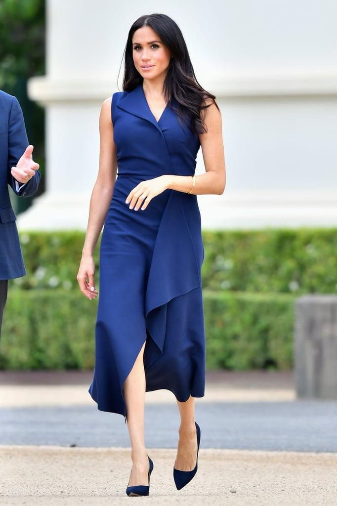 Navy has been having a real moment in Meghan Markle's Autumn wardrobe. The duchess's fashion picks have all been unstoppable during her 16-day royal tour with Prince Harry — but her look for the couple's outing in Melbourne reminds us of a few other stunning outfits she's worn recently.  While Meghan kept things casual in jeans and blouse the day before, she made a more formal selection for the tour's third stop and opted for a sleeveless navy dress by Australian designer Dion Lee. Meghan seems to have been reaching for this regal deep blue shade more and more over the past few months, whether its in a belted top or royal wedding guest outfit.  Meghan teamed her tour ensemble with other nods to navy, including matching Manolo Blahnik BB pumps (£535) and a Gucci mini chain clutch (£805). Meghan tied the whole look together with a Shaun Leane cuff (£950) and her trusty Martin Grant trench coat. See more photos of the glowing mum-to-be in her polished look ahead — she certainly has her sophisticated maternity style down to an art form.       Related:                                                                                                           Meghan Markle Traded Her Heels For These Flats, and We Couldn't Love Her More