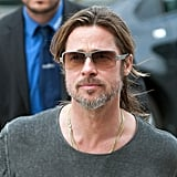 Brad Pitt wore his long hair back as he walked through Germany.