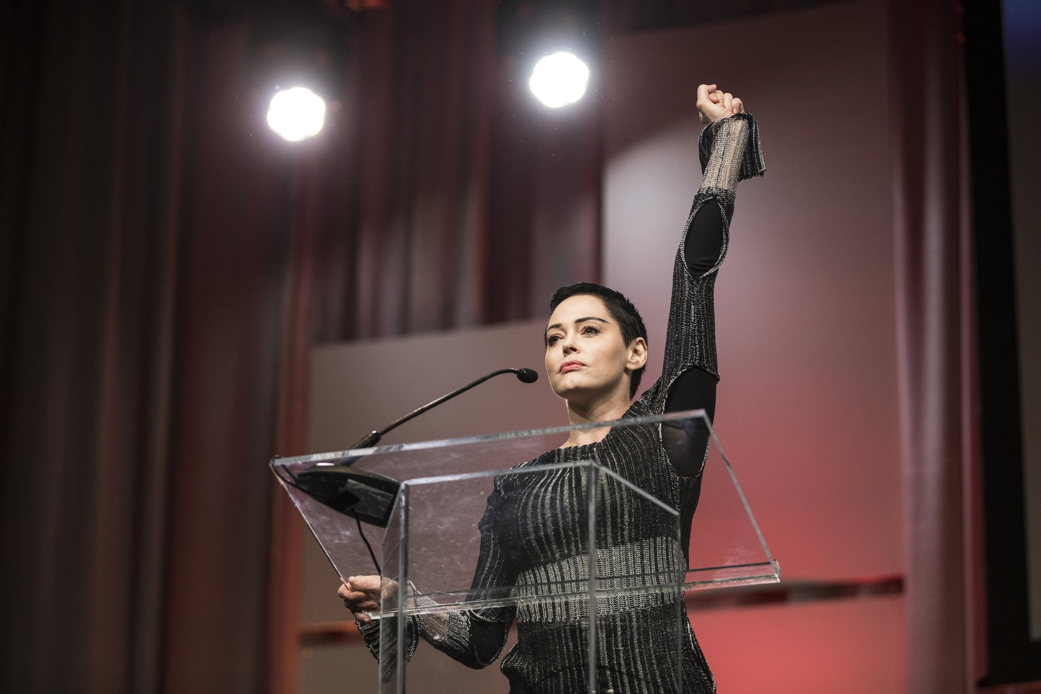 October 27, 2017 - Michigan, U.S. - Rose McGowan raises her fist as she speaks during The Women's Convention at Cobo Center in downtown Detroit, Friday, October 27, 2017. (Credit Image:  Detroit Free Press via ZUMA Wire)
