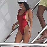 Styling Her Tiny Sunglasses With a Red High-Leg Swimsuit