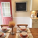 The finds: the table settings, pumpkins, and chalkboard in this dining room are from HomeGoods.
