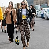 A Graphic Tee and Leather Jacket Might Be the Most Classic Match For Leopard Trousers