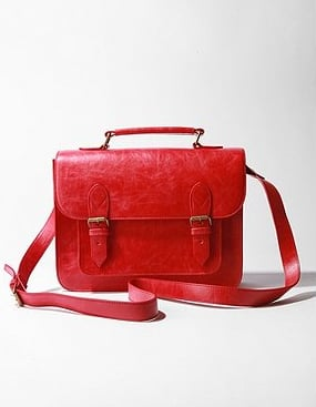A pop of red takes a classic satchel into cooler color territory.   BDG Primary Satchel ($58)