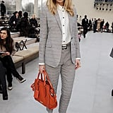 At the Burberry Prorsum show in February 2013, a sharp suit and statement bag made Suki stand out from the crowd.