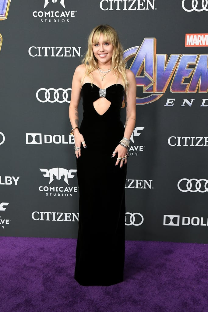 Miley Cyrus must have quite the selection of sexy black dresses hanging in her closet. The 26-year-old singer owns LBDs, plunging gowns, and strappy numbers, yet she somehow still finds ways to surprise us with new variations. On April 22, she and her husband Liam Hemsworth supported his brother Chris at the Avengers: Endgame premiere. Despite not being a part of the cast, Miley found a way to steal the show, thanks in part to her custom Yves Saint Laurent gown.  The sleek material gave the ensemble a classic feel, while the peekaboo detailing in the center added a sultry touch. She paired the skintight dress with layered necklaces and bracelets from Sydney Evan, Jared Lehr and Loree Rodkin, plus rings on every finger. Ahead, see Miley's look from all angles. It's clear she's feeling herself on the red carpet, and we can't blame her!       Related:                                                                                                           Miley Cyrus Is So Malibu in Her Chanel Overalls and Pool Slides