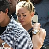 Miley Cyrus wore gold accessories.