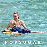 Naomi Splashes Around in a Bikini With Shirtless Liev Schreiber & Sons
