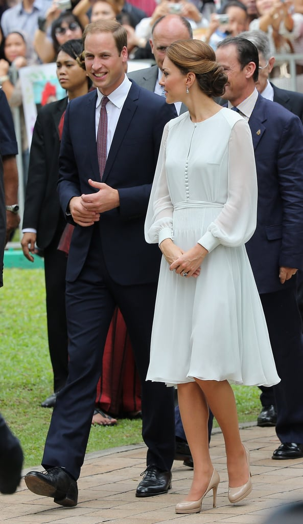 She chose a sheer-sleeved Beulah London dress, in the palest pastel blue, to tour a mosque in Kuala Lumpur, while Prince William stuck to a classic navy blue suit.