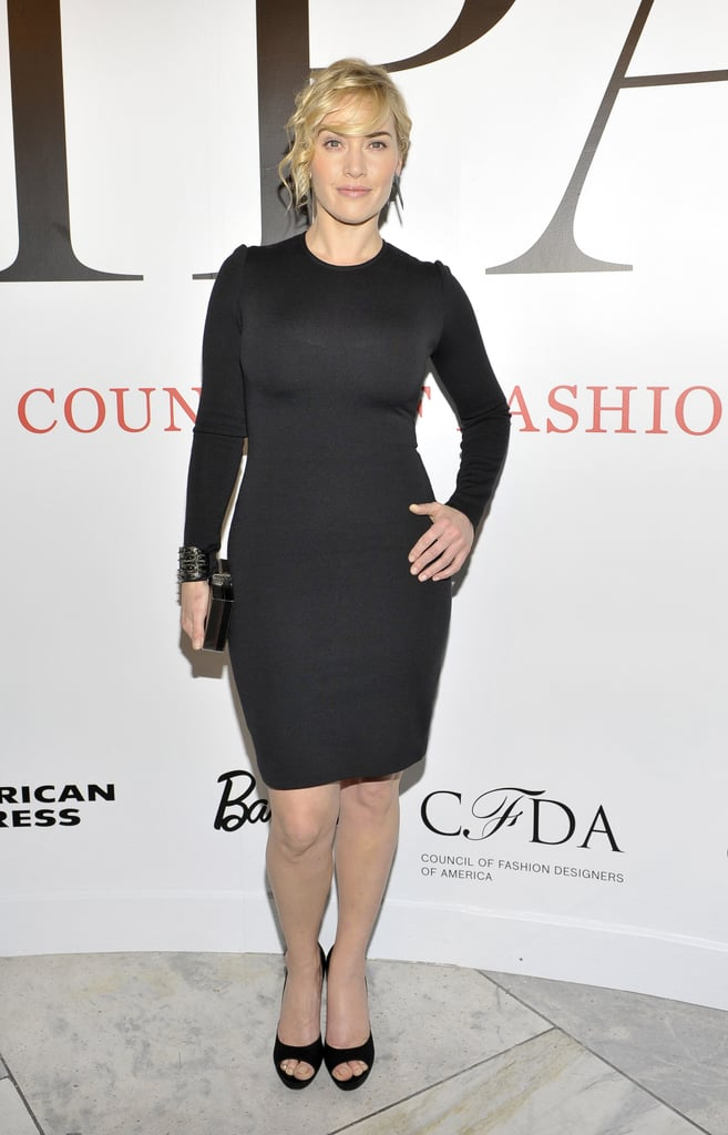 "Kate Winslet joined the many famous faces at NY Fashion Week as she stepped out in the Big Apple last night. She attended the opening of CFDA's new exhibition at FIT called ""Impact: 50 Years of the CFDA."" Kate, who is the current face of St. John, wore a fitted black dress from the line and was accompanied by St. John designer George Sharp and CFDA CEO Steven Kolb for the occasion. Also on hand to see the work on display were Prabal Gurung, Vera Wang, Lorraine Schwartz, and Anna Wintour.  Kate's coming off an exciting award season win last month. Kate picked up a Golden Globe for her work in Mildred Pierce and was joined by boyfriend Ned Rocknroll at the big show."