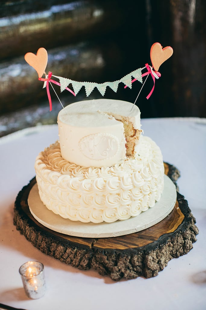 Hearts and pearl piping — does it get any girlier than that? We love the sweet touch this cake adds to the reception.