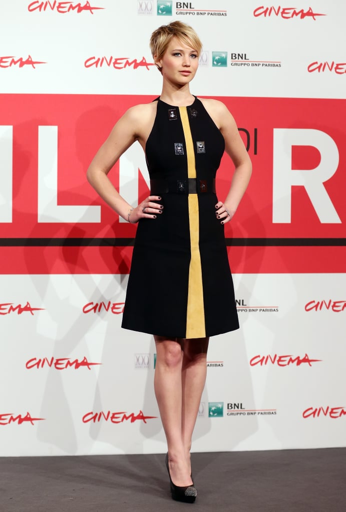 Jennifer Lawrence looked like a young Ellen Barkin when she made another pit stop during her press tour for The Hunger Games: Catching Fire in Rome on Thursday. She was joined by her costars Liam Hemsworth and Josh Hutcherson for a photocall ahead of the premiere of their new flick at the Rome Film Festival. The trio aren't the only Hollywood stars who have brought their film to Italy over the past few days. Jared Leto premiered Dallas Buyers Club over the weekend while Scarlett Johansson, Rooney Mara, and Joaquin Phoenix brought their movie, Her, to the Italian city earlier this week.  Jennifer, Josh, and Liam have been on a whirlwind tour to promote the newest Hunger Games film. On Tuesday, the cast stopped by Madrid to premiere Catching Fire in Spain. Spain and Italy are hardly the only cities that they have visited over the past week — check out the best moments from the Catching Fire press tour.