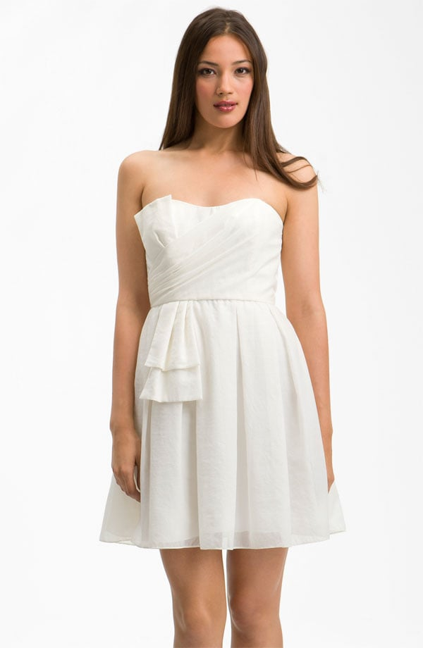For the girlie and glam bride, this little strapless has the best of both worlds — a classic fit with a hint of pretty detail.  Jill Stuart Sweetheart Neckline Bow Detail Dress ($248)
