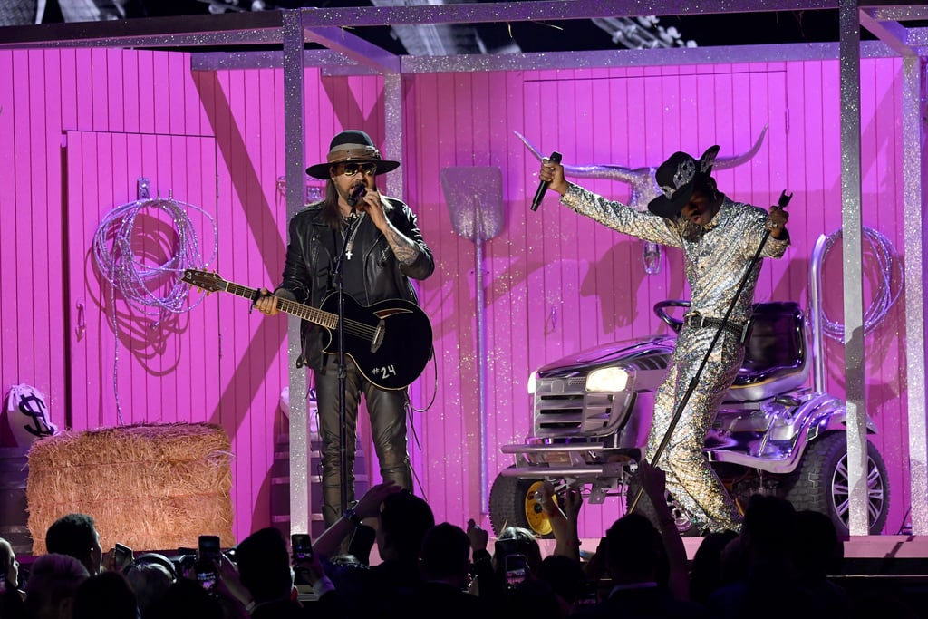 "If there was ever a man to bring rodeo to the Grammys stage, it had to be Lil Nas X. On Sunday night, the singer took the Grammy stage for the first time for one of the night's biggest performances, an all-star rendition of his record-breaking hit, ""Old Town Road."" If you weren't itching to rock a Stetson and some boots after watching that performance, you need to see it again! Not only was Lil Nas X joined by his first remix partner, Billy Ray Cyrus, but his collaborators on the song's later remixes chimed in as well. Everyone from rapper Nas, yodelling star Mason Ramsey, Diplo, and K-pop boy band BTS hopped onstage for their versions of the song, and the audience was digging the mashup. The singer walked through a revolving stage with different themed rooms for every remix, before ending with a duet with Nas, dressed like a country version of The Matrix's Morpheus. Watch the eclectic performance ahead!      Related:                                                                                                           Billie Eilish, Lizzo, Lil Nas X, and Everyone Else Who Took Home a Grammy This Year"