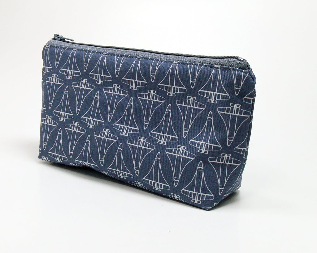 The fresh geometric print of this Cosmetic Bag ($15) is actually composed of small space shuttles!