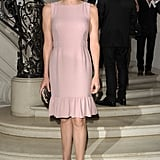 Princess Charlene graced the Christian Dior show in a ruffle-hemmed petal pink shift.