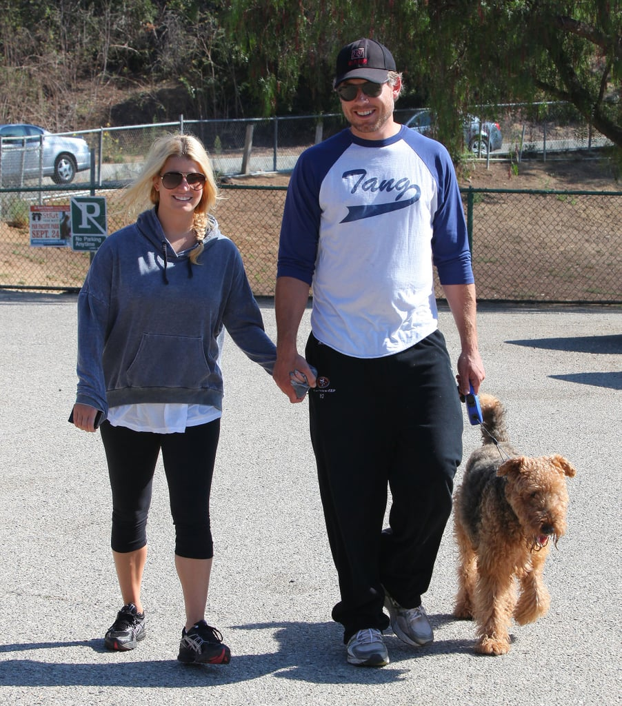 The couple held hands while walking their dog in LA in September 2011.