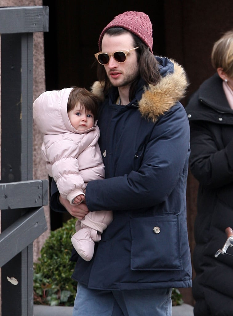 Tom Sturridge carried his daughter, Marlowe, in his arms when he took a stroll in NYC in March.