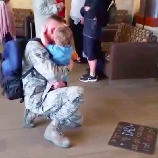 Military Dad Reunites With His Daughter Holding a Sign