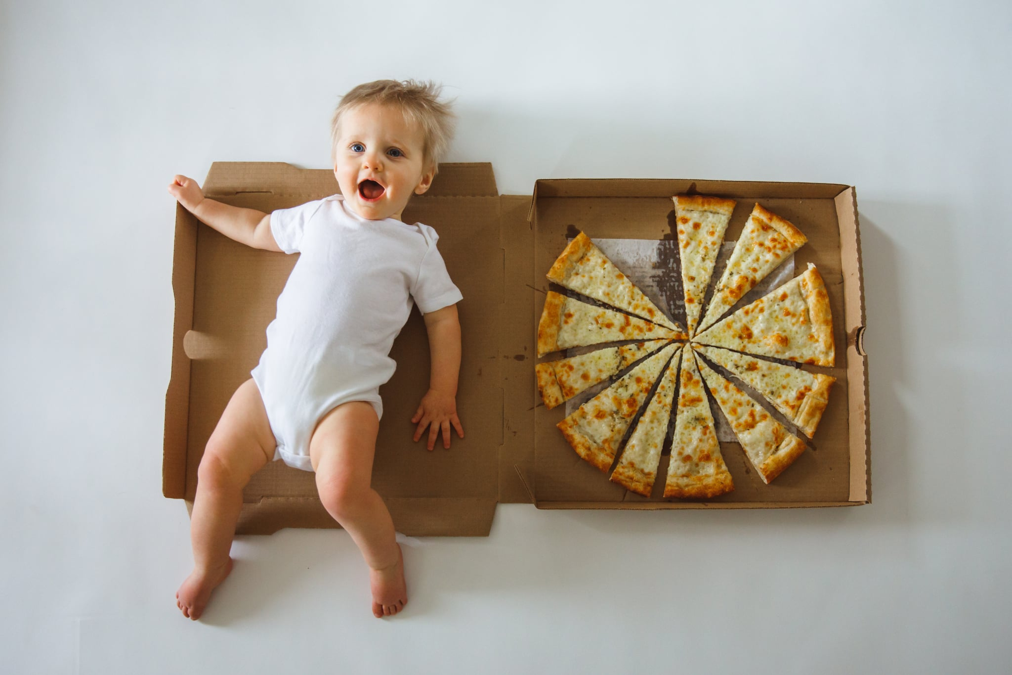 Baby S Monthly Milestone Photos With Pizza Slices Popsugar Family