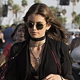 She accessorized with perfect festival flair, like a choker necklace layered with a longer chain, and finished with a scarf and shades.