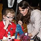 Kate Middleton checked out a little girl's art project during a November 2012 visit to the Manor School in Cambridge, England.