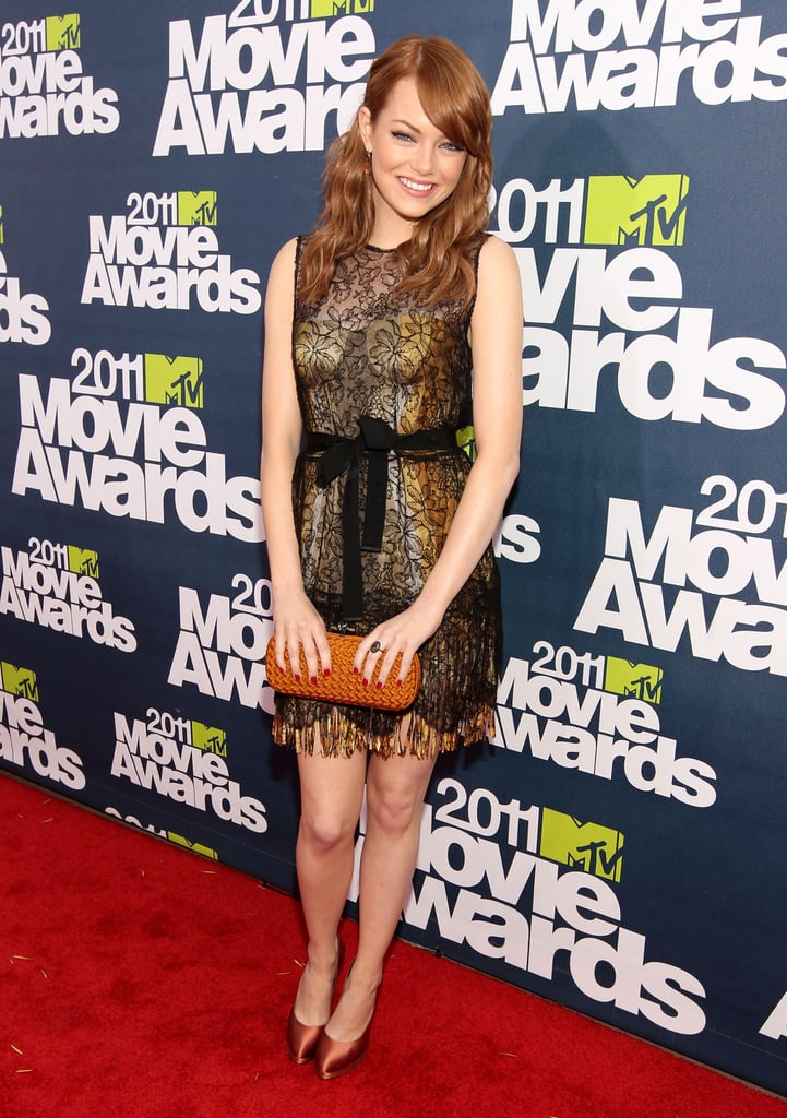 Emma Stone showed off her back-to-red locks on the carpet at this evening's MTV Movie Awards in Universal City. The hair color, which she debuted earlier in the week, signifies she's done with work as a blonde in The Amazing Spider-Man and she sported a lacy Bottega Veneta dress to go with it. Emma met up with her spidey Andrew Garfield inside, and we spotted the two hugging hello. Emma and Easy A are up for a handful of awards during tonight's show, including best comedic performance and best female performance for her work in the film. Once inside, she also reunited with her Crazy, Stupid, Love costars Ryan Gosling and Steve Carell. Stay tuned for more photos and news as we update live from inside the show throughout the night, and make sure to check out FabSugar and BellaSugar's love it or leave it polls!