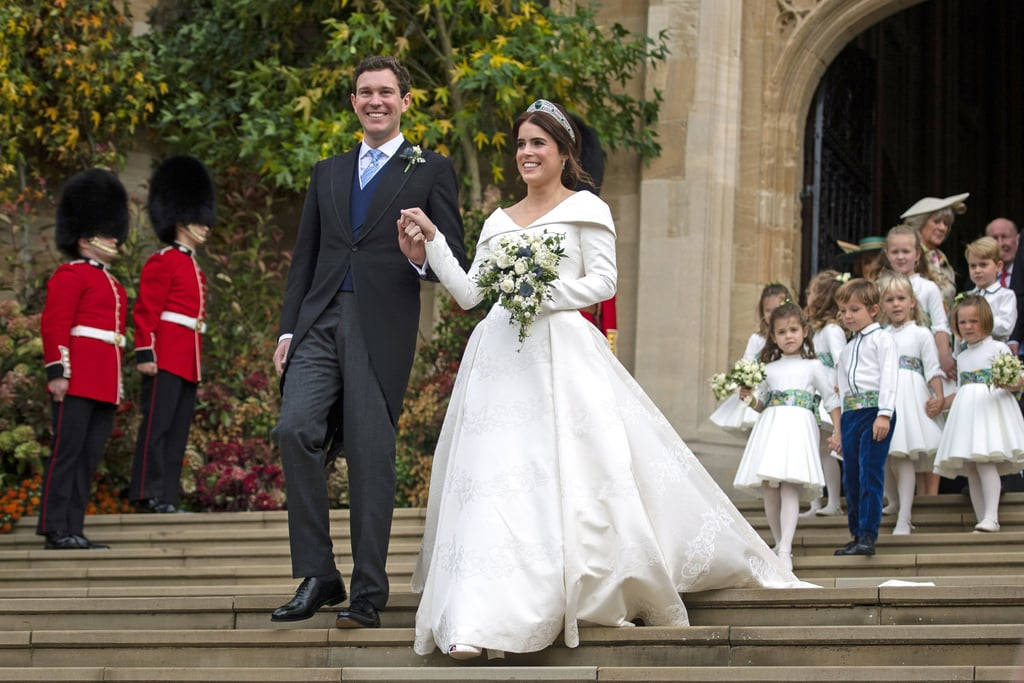 """It's official — Princess Eugenie and Jack Brooksbank are husband and wife! The couple tied the knot at Windsor Castle's St. George's Chapel (yep, the same place where Prince Harry and Meghan Markle got married) on Oct. 12, and the royal affair was straight out of a fairy tale. The 28-year-old princess looked positively radiant in an opulent white gown designed by Peter Pilotto and was escorted by her dad, Prince Andrew. Jack, on the other hand, cut a suave figure in a traditional morning suit and couldn't have looked any happier as he watched Eugenie make her way down the aisle.  Eugenie and Jack exchanged vows in front of their nearest and dearest, including Princess Beatrice, Sarah Ferguson, Queen Elizabeth II, Prince William, and celebrities like Ellie Goulding,  Liv Tyler, Naomi Campbell, as well as a heavily pregnant Pippa Middleton. Prince George and Princess Charlotte served in their wedding party as a pageboy and flower girl, respectively, along with Beatrice, who was Eugenie's maid of honor. Just like Harry and Meghan, Eugenie and Jack also invited 1,200 members of the public to be part of their special day. How sweet, right? Eugenie first met the wine merchant during a ski trip to Switzerland in 2010 and got engaged this past January. """"[It] was love at first sight,"""" Jack said during their first interview as an engaged couple. """"We met when I was 20, he was 24,"""" Eugenie added. """"[We] fell in love. We have the same passions and drive for life."""" Congrats to the newlyweds!       Related:                                                                                                           Royal Fetes and Red Carpets: Princess Eugenie Through the Years"""