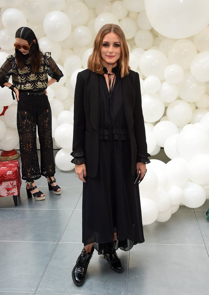 For a day of shows at London Fashion Week, Olivia gave all black an update in a boho-style dress and blazer — and combat boots to top the whole thing off.