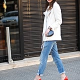 Moto jackets feel infinitely more seasonal in white — and even cooler juxtaposed against a bright pair of pumps. Source: Lookbook.nu