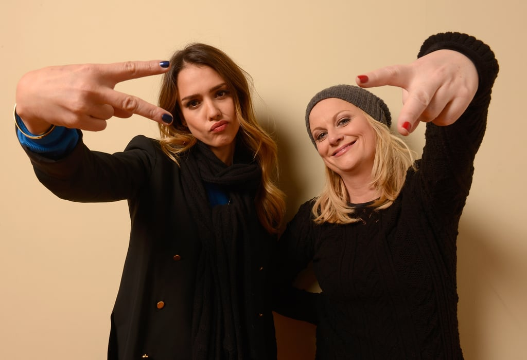 Jessica Alba and Amy Poehler had fun in front of the camera showing off their colorful manicures. We love the punch of blue and red against their all-black outfits.