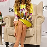 Sarah Jessica Parker sat in a yellow dress.
